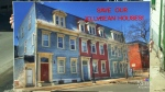 A rally in Saint John was held on Saturday against selling identically-built old homes painted different colours.