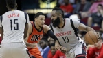 Houston Rockets' Clint Capela blocks Oklahoma City Thunder's Andre Roberson as James Harden drives around them during the second half of an NBA basketball game in Houston on Sunday, March 26, 2017. (AP / Michael Wyke)