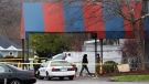 Members of the ATF and local police work at a crime scene at the Cameo club after a fatal shooting, Sunday, March 26, 2017, in Cincinnati. (AP Photo/John Minchillo)
