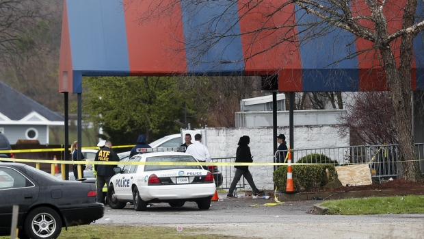 Members of the ATF and local police work at a crime scene at the Cameo club after a fatal shooting in Cincinnati on Sunday, March 26, 2017. (AP / John Minchillo)