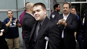 Police officers and supporters clap as Officer Richard Haste, centre, exits the courthouse after posting bail in New York on June 13, 2012. (AP / Seth Wenig)