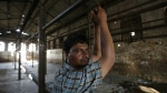 Mehta, 40, stands at a slaughter house where he used to work after it was shut down by authorities in Allahabad, India on Sunday, March 26, 2017. (AP / Rajesh Kumar Singh)