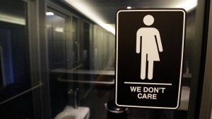 A sign outside a restroom at 21c Museum Hotel in Durham, N.C., on May 12, 2016. (Gerry Broome / AP)