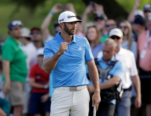 Dustin Johnson celebrates after sinking a putt to defeat Jon Rahm, of Spain, at the Dell Technologies Match Play golf tournament at Austin County Club, Sunday, March 26, 2017, in Austin, Texas. (AP / Eric Gay)