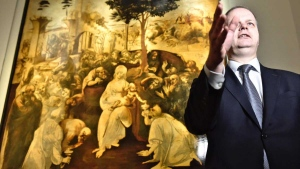 Uffizi museum manager Erik Smith gestures as Leonardo da Vinci's 'Adoration of the Three Wise Men' is returned to the public after 6 years of study and restoration, in Florence, Italy, Monday, March 27, 2017. (Maurizio Degl' Innocenti/ANSA via AP)