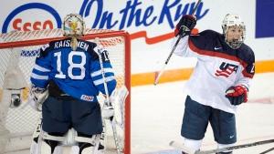 United States' Hilary Knight celebrates after scoring against Finland goaltender Meeri Raisanen in Kamloops, B.C. on March 29, 2016. (Ryan Remiorz/The Canadian Press via AP)