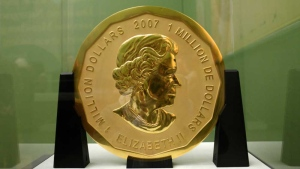 The Dec. 12, 2010 file photo shows the gold coin 'Big Maple Leaf' in the Bode Museum in Berlin. The 100-kilogram (220 pound) gold coin disappeared from the museum. (Marcel Mettelsiefen/dpa via AP)