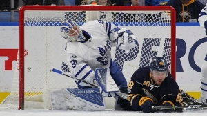 Buffalo Sabres forward William Carrier (48) collides with Toronto Maple Leafs goalie Frederik Anderson (31) during the first period of an NHL hockey game, Saturday, March 25, 2017, in Buffalo, N.Y. (AP Photo/Jeffrey T. Barnes)