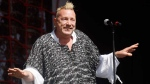 FILE - In this June 30, 2013, file photo, John Lydon performs with his band PiL at the Glastonbury Music Festival at Glastonbury, England. Lydon, whose also known by his stage name, Johnny Rotten, told ITV's 'Good Morning Britain' on March 27, 2017, that he supports U.S. President Donald Trump. (Photo by Jim Ross/Invision/AP, File)