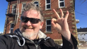 Bill Steele poses in a selfie in front of a former jail in Dorchester, N.B. in this undated handout photo. (THE CANADIAN PRESS / HO - Bill Steele)