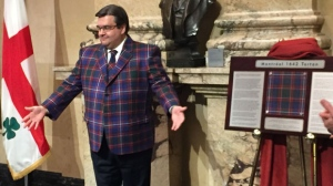 Montreal Mayor Denis Coderre shows off the city's tartan.