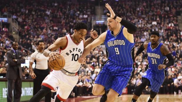 Toronto Raptors guard DeMar DeRozan drives past Orlando Magic centre Nikola Vucevic during first half NBA basketball action, in Toronto on Monday, March 27, 2017. (Frank Gunn / THE CANADIAN PRESS)