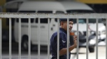 A Malaysian police officer closes the main gate of forensic department at Kuala Lumpur Hospital in Kuala Lumpur, Malaysia Tuesday, March 28, 2017. (AP / Daniel Chan)