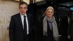 French presidential candidate Francois Fillon, left, and his wife Penelope arrive for a television debate at French TV station TF1 in Aubervilliers, outside Paris, France, Monday, March 20, 2017. (Patrick Kovarik/Pool Photo via AP)