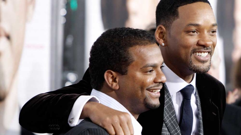 In this Dec. 16, 2008, file photo, Will Smith, right, and Alfonso Ribeiro pose together at the premiere of 'Seven Pounds' in Los Angeles. (AP Photo/Matt Sayles, File)