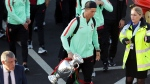 Cristiano Ronaldo carries the Euro 2016 European soccer championship trophy at the Madeira airport outside Funchal, Portugal, on March 27 2017. (Armando Franca / AP)