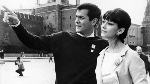 In this July 11, 1963 file photo U.S. actor Tony Curtis and his German-born wife, actress Christine Kaufmann stroll at the Red Square in Moscow, Soviet Union, during the 3rd International Moscow Film Festival. Christine Kaufmann died Tuesday, March 28, 2017. She was 72. (AP Photo)