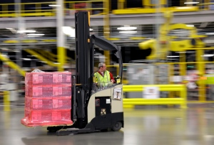 In this Feb. 13, 2015, file photo, a forklift operator moves a pallet of goods at an Amazon.com fulfillment center in DuPont, Wash. (AP / Ted S. Warren)