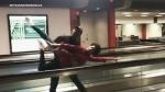 Dancers perform an impromptu show after flight de