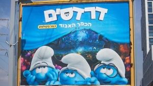 A poster for the Smurfs, The Lost Village, movie is seen in the central Israeli city of Bnei Brak. The PR firm promoting 'Smurfs: The Lost Village' says it removed Smurfette from promo posters in central city of Bnei Brak so as not to offend its ultra-Orthodox Jewish residents. (AP Photo/Sebastian Scheiner)