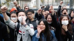 Demonstrators from the Asian community protest outside Paris' 19th district's police station, on March 28, 2017. (Michel Euler / AP)