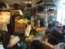 This undated photo provided by Regina Lark shows a garage organization project in Los Angeles, Calif. This image shows a garage before being organized to the client's goals. (Regina Lark via AP)
