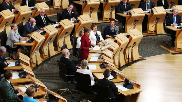 Scotland's First Minister and Scottish National Party leader, Nicola Sturgeon, speaks during the opening of the fifth session of the Scottish Parliament in Edinburgh, Saturday July 2, 2016. (Andrew Milligan/PA via AP)
