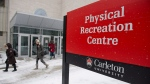 People walk past the Physical Recreation Centre at Carleton University in Ottawa on Tuesday, March 14, 2017. (Justin Tang / The Canadian Press)