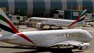 This May 8, 2014 file photo shows Emirates passenger planes at Dubai airport in United Arab Emirates. (Kamran Jebreili / AP)
