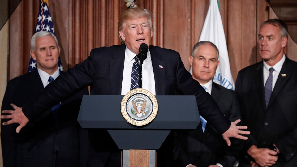President Donald Trump, accompanied by from left, Vice President Mike Pence, Environmental Protection Agency (EPA) Administrator Scott Pruitt, and Interior Secretary Ryan Zinke, speaks at EPA headquarters in Washington, Tuesday, March 28, 2017, prior to signing an Energy Independence Executive Order. (AP Photo/Pablo Martinez Monsivais)