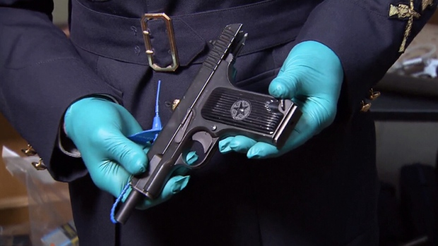 Police recovered more than a dozen firearms, many of which had illegal modifications.