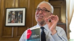 Quebec Finance Minister Carlos Leitao displays his budget speech, on the eve of a provincial budget speech in Quebec City on Monday, March 27, 2017. (Jacques Boissinot / THE CANADIAN PRESS)