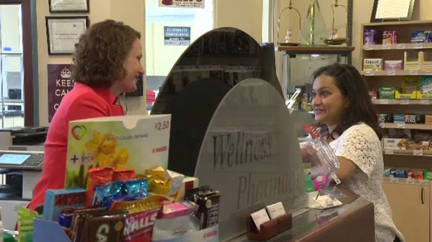 Meaghan Reaburn talks to Monica Hazra at Beechwood Wellness Pharmacy, a few days after the pharmacist came to Hazra's rescue when she went into anaphylactic shock.