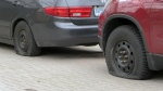 Vehicles with slashed tires are seen in a driveway in Waterloo on Tuesday, March 28, 2017.
