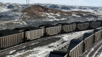 Rail cars are filled with coal and sprayed with a topper agent to suppress dust at Cloud Peak Energy's Antelope Mine north of Douglas, Wyo. on Jan. 9, 2014. (Ryan Dorgan / Casper Star-Tribune)