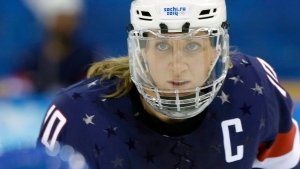 FILE - In this Feb. 17, 2014, file photo, Meghan Duggan of the United States looks up during a face off during the second period of the 2014 Winter Olympics women's semifinal ice hockey game against Sweden at Shayba Arena in Sochi, Russia. (AP Photo/Mark Humphrey, File)