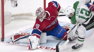 Montreal Canadiens goalie Carey Price (31) stops Dallas Stars centre Radek Faksa (12). THE CANADIAN PRESS/Ryan Remiorz