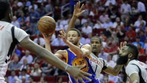 Golden State Warriors' Stephen Curry (30) dishes the ball between Houston Rockets' Clint Capela, Trevor Ariza (1) and James Harden (13) in the first half of an NBA basketball game in Houston, Tuesday, March 28, 2017. (AP / Michael Wyke)