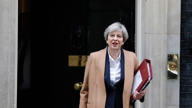Britain's Prime Minister Theresa May leaves 10 Downing Street on her way to the House of Commons in London, Wednesday March 29, 2017.  (AP Photo/ Kirsty Wigglesworth)