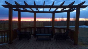 Morning sunrise from deck in Sage Creek. Photo by Adam Strauman.