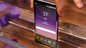 Samsung Galaxy S8 mobile phone is shown partially submerged to demonstrate its water resistance, in New York, on March 24, 2017. (Richard Drew / AP)
