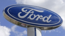 This Tuesday, Jan. 17, 2017, photo shows a Ford sign at an auto dealership. (Source: Alan Diaz/AP Photo)
