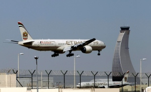 In this May 4, 2014 file photo, an Etihad Airways plane prepares to land at the Abu Dhabi airport in the United Arab Emirates.(AP / Kamran Jebreili)