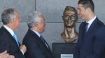 Portuguese president Marcelo Rebelo de Sousa, left, Portuguese Prime Minister Antonio Costa, 2nd left and Real Madrid's Cristiano Ronaldo stand next to a bust of the player at the Madeira international airport outside Funchal, the capital of Madeira island, Portugal, Wednesday March 29, 2017. (AP Photo/Armando Franca)