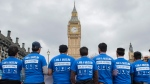 Members of Ahmadiyya Muslim Association during a commemorative event outside Parliament in London, on March 29, 2017. (David Mirzoeff/ PA via AP)