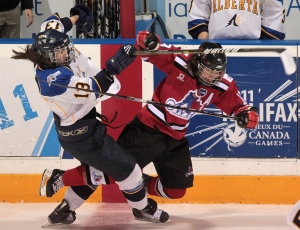 Team Alberta's Melissa Kueber (left) and Team Ontario's Erin Ambrose collide during the second period of the women's hockey gold medal game on Saturday, February 26, 2011 at the 2011 Canada Winter Games in Halifax, N.S. (Mike Dembeck / THE CANADIAN PRESS)