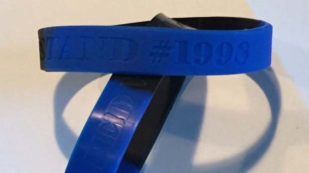 Members of the Ottawa Police purchase 'United We Stand' wristbands in support of Constable Daniel Montsion. Montsion is charged with manslaughter in the July 2016 death of Abdirahman Abdi.