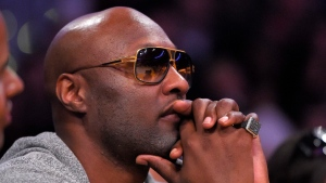 In this March 30, 2016, file photo, former Los Angeles Lakers' player Lamar Odom watches during the second half of an NBA basketball game between the Lakers and the Miami Heat in Los Angeles. (Mark J. Terrill / AP)