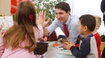 Prime Minister Justin Trudeau meets with children at a YMCA-YWCA day care centre in Winnipeg, Wednesday, March 29, 2017. (THE CANADIAN PRESS/John Woods)