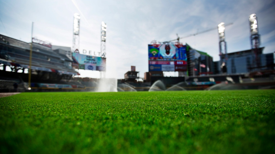 The field is watered at SunTrust Park in Atlanta, on March 29, 2017. (David Goldman / AP)